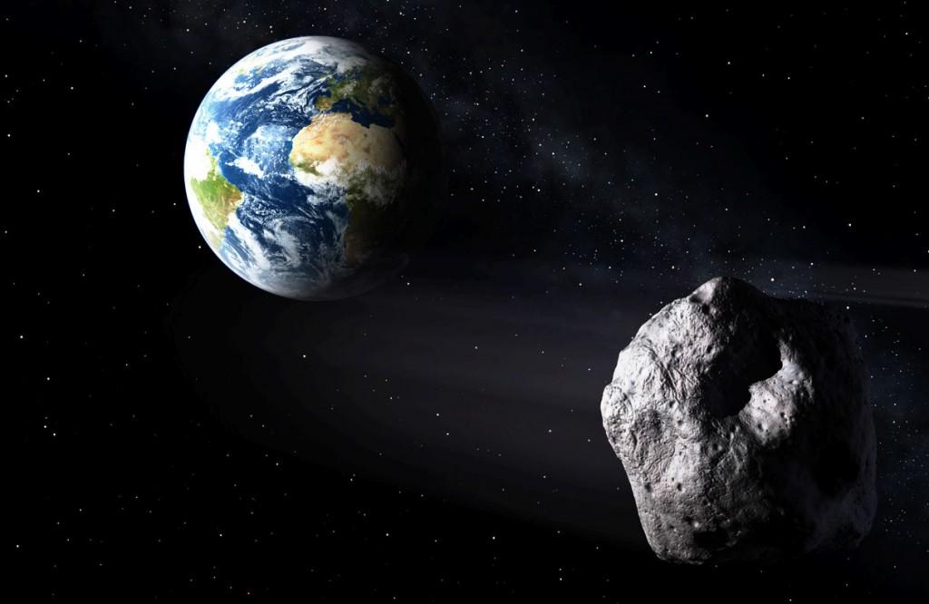 Concepção artística de asteroide passando de raspão pela Terra. (Crédito: ESA)