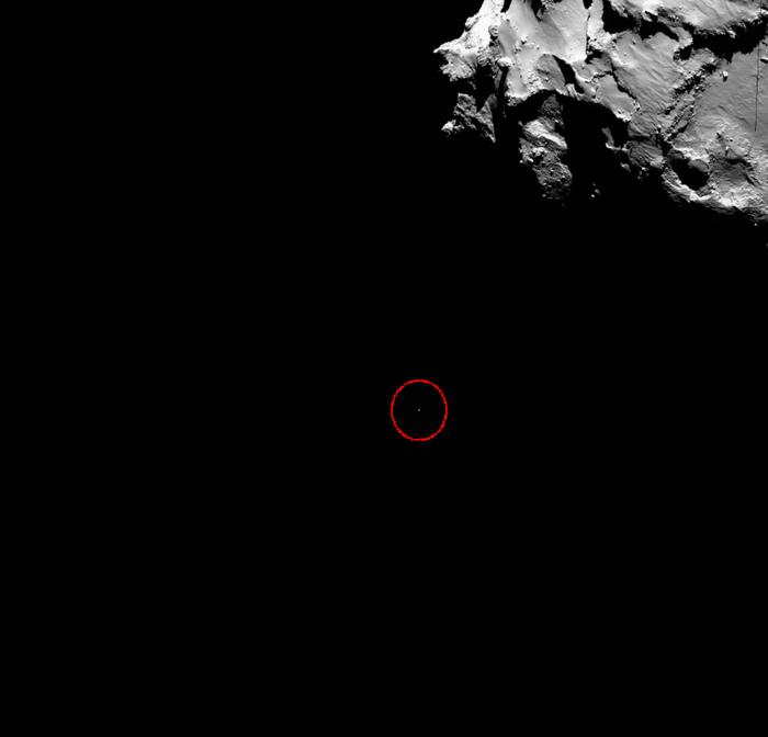 Imagem da Rosetta mostra o pequeno Philae descendo rumo ao cometa.