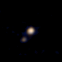 Imagem colorida de Plutão e Caronte obtida pela New Horizons em 9 de abril (Crédito: Nasa)