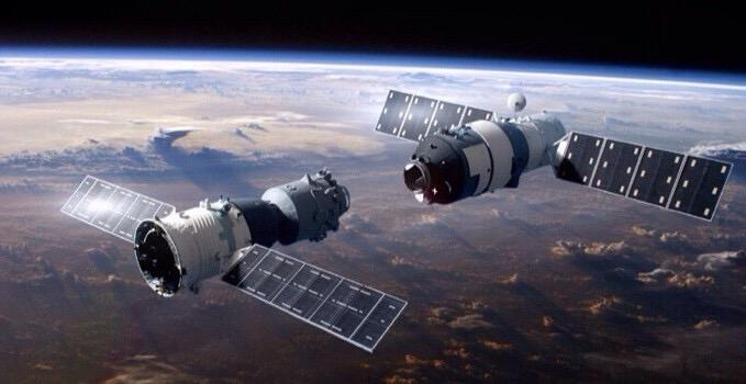 Concepção artística da Tiangong-2 recebendo a visita da Shenzhou-11 (Crédito: CNSA)